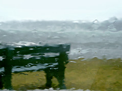 lonely bench (pictureperfect4life) Tags: ocean sea abstract green rain bench waves