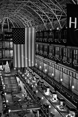 the arcade desaturated (.:Chelsea Dagger:.) Tags: christmas old ohio usa history architecture night america 35mm court mall photography lights hotel downtown unitedstates balcony flag cleveland arcade victorian skylight americanflag indoor clevelandohio nighttime american shops historical hyatt euclid stores brass regency richardsonian chelseadagger chelseakaliwhatever cmckeephotography chelseamckee