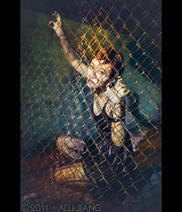 steel net. (Alli Jiang) Tags: portrait girl beautiful beauty face night fence asian photography wire model pretty availablelight cage chainlink caged flashlight wired shorthair asiangirl nightportrait lockedup wirefence 2011 flashlightphotography annielee allijiang wsyt520