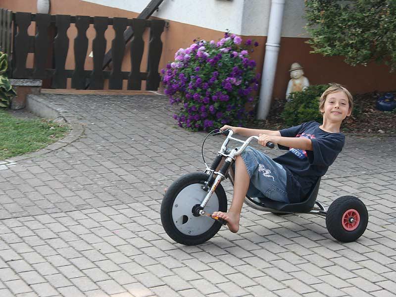 Ferienwohnungen Miehling - Junge auf dem Dreirad