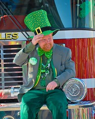 Leprechaun on Parade (Scottwdw) Tags: city red people newyork man reflection hat hair beard nikon central parade firetruck bumper cny syracuse stpatricksday leprechaun smle d700 yourphototips onondagacountry afsnikkor28300mmf3556gedvr scottthomasphotogrphy