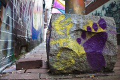 Painted Footprint (Joshua Drew Vaughn) Tags: cambridge usa colors boston wall america graffiti alley colorful paint artist purple massachusetts footprint