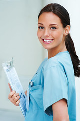 Young cute nurse looking at the camera and smiling (Felbry College) Tags: blue girls portrait people woman girl beautiful beauty smile smiling modern female happy person women uniform pretty background space happiness scienc