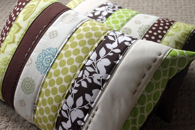 green + brown + cream pillows