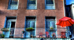 Wrought Iron Red (Ken Yuel) Tags: unitedstates balcony neworleans frenchquarter lousiana umbrellas ironrailings redumbrella patiofurniture wroughtironfurniture wroughtironrailings redfurniture digitalagent kenyuel redironfurniture