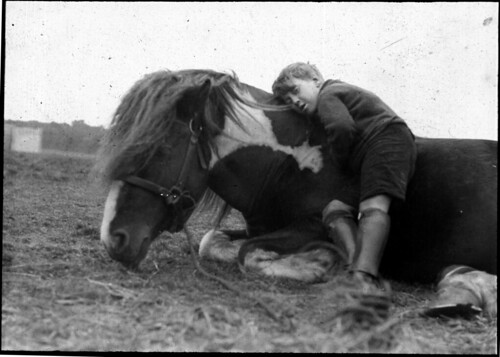 Horse and boy lying down by Tyne & Wear Archives & Museums