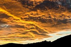 lo que ocurre en el cielo cuando se enfadan los dioses (soybuscador) Tags: sunset espaa atardecer spain nikon ibiza cielo nubes otoo octubre monte naranja baleares 1110 2011 canmisses d7000 nubesdeotoo soybuscadorgmailcom