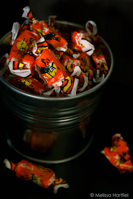 A bucket of molasses kisses viewed from overhead