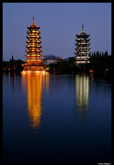 Gold, silver and blue (Dan Wiklund) Tags: china city longexposure blue urban lake silver temple gold cityscape guilin buddhist bluehour d200 guanxi twinpagodas 2011 pagona shanlake sunpagoda moonpagoda
