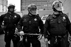 Occupy Oakland (13 of 20) (glennshootspeople) Tags: california street blackandwhite corporate rebel 1 movement cops political rally protest streetphotography photojournalism police social solidarity 99 unite cop revolution marching rebellion change anarchy anarchism activism economic financial revolt baton officer protesters activist socialism greed riotgear downtownoakland rebels classwar inequality frankogawaplaza opd d90 ows occupy corporategreed streetmarch socialinequality nikon2485mm nikond90 economicinequality glennhalog occupywallstreet wearethe99 occupytogether occupyeverywhere occupyoakland downtownoak glennshootspeople