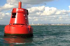 Buoy with Portsmouth beyond... (Charles Smallman) Tags: seaside statues isleofwight solent portsmouth buoys vacations breakwater hmswarrior buoyant sandownbay nikon700 charlessmallman nomansbuoy charlessmallmansportfoliojanuary