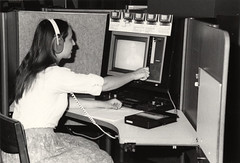 Student at videocassette player in the M.D. Anderson Library