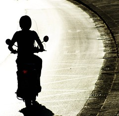 bend (gregjack!) Tags: road light shadow red italy texture silhouette bend pavement pisa motorcycle curve moped