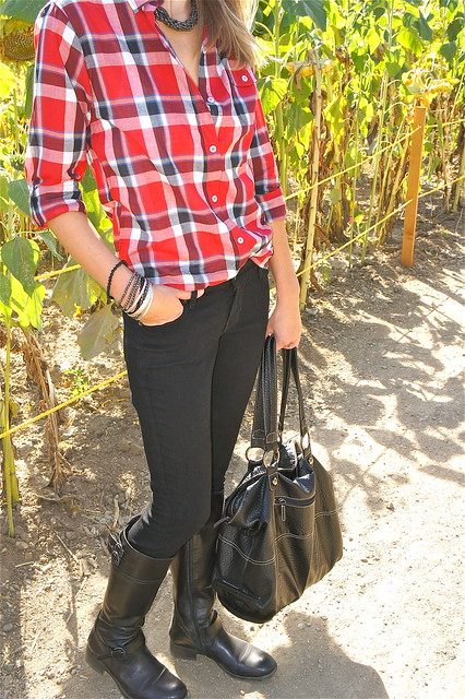 Black skinny jeans with red plaid shirt