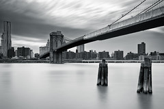 Manhattan - Long Exposure Study #1 (Sebastian (sibbiblue)) Tags: longexposure blackandwhite bw panorama usa newyork water skyline brooklyn dumbo brooklynbridge 18105 daytimelongexposure neutraldensity nd110 bwnd110 nikond7000