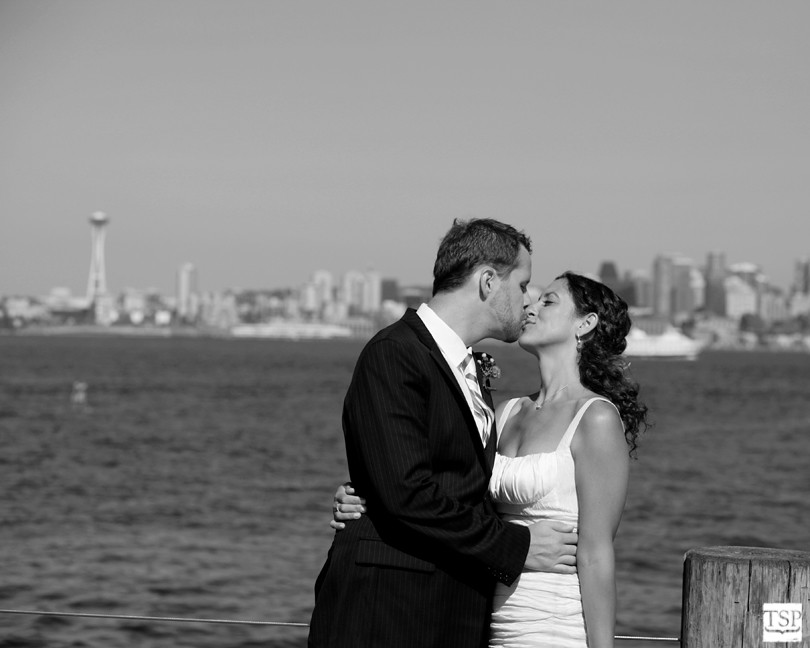 Bride and Groom Kissing in Front of Seattle Space Needle