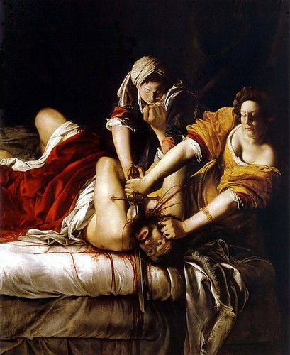 Judith Beheading Holofernes: a painting of two women taking a man's head off with a sword