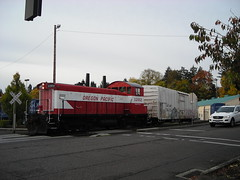 OPR 1202 pushes a refrigerator car into a siding in the Milwaukie industrial park