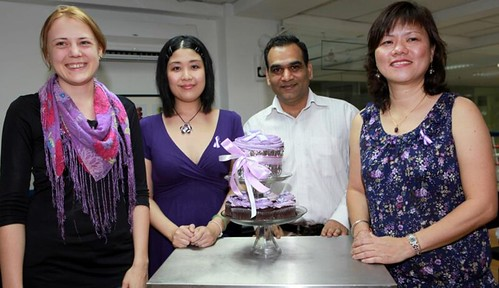 Representatives from The Pixel Project, WAO and the Academy of Pastry Arts with the giant cupcake!