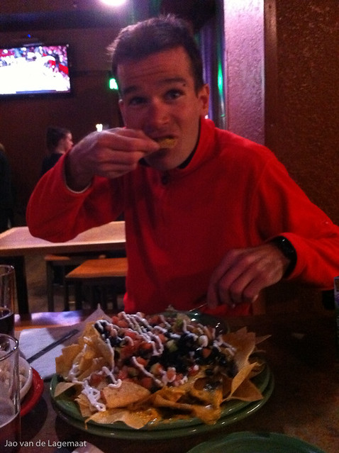 Jean David at Tommyknocker eating the traditional enormous plate of nachos.