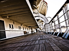 Promenade Deck SS Rotterdam (PeterJ) Tags: holland history netherlands dutch port fence bench rotterdam harbour olympus lifeboat porthole handrail cinematic fenced railings zuiko lr lightroom teak hff rotjeknor 2011 m43 mft ssrotterdam epl1 918mm happyfencefriday frompeterj
