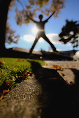 Jumping (hyfumc) Tags: shadow silhouette backlight canon jump bokeh 7d 2011 project365 photobycindy 1635mmii cindychouphotography