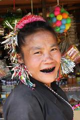 Akha tribal woman near the village of Wan Pin, Shan state, Myanmar / Burma (sensaos) Tags: travel portrait people woman black smile face smiling costume asia state burma teeth traditional tribal jewellery myanmar shan tribe ethnic birma indigenous azie shanstate akha betelnut azi birmese sensaos kalahumyat