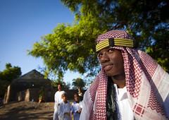 Muslim maulidi procession in Lamu - Kenya (Eric Lafforgue) Tags: africa smile island kid kenya muslim islam culture unescoworldheritagesite afrika tradition lamu prophet muhammad islamic headdress swahili afrique headwear headgear eastafrica mawlid qunia lafforgue maulidi  qunia    kea 125783   tradingroute a