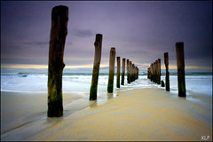 Piles at St Clair (katepedley) Tags: new wood newzealand beach lines st canon island sand waves timber jetty perspective zealand wharf southisland dunedin 5d poles clair leading 1740mm piles relict polariser gndfilter diverging