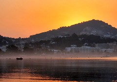 Buenos Das Ibiza! (Serge Freeman) Tags: morning sea orange seascape water fog sunrise boat spain day hill