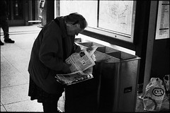 Paperwork (anauhu) Tags: street leica old people blackandwhite bw woman film analog trash 50mm candid grain hannover bin hauptbahnhof sw hp5 ttl bags rodinal m6 elmar newsletter