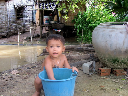 Small Boy washing with Bucket
