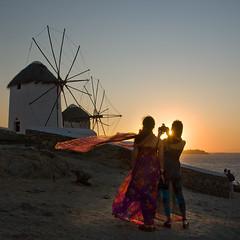 Mykonos Sunset (Ian@NZFlickr) Tags: girls sunset windmill scarf photography women bravo windmills greece pointandshoot radiant mykonos