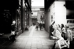 Sole Trader (Explored) (stephen cosh) Tags: life street leica city people blackandwhite bw sepia mono scotland town unitedkingdom glasgow candid streetphotography rangefinder reallife m9 humancondition blackandwhitephotos blackwhitephotos stephencosh