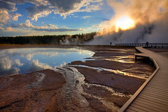 Morning at Midway Geyser Basin (Rozanne Hakala) Tags: park morning usa sun tourism water pool clouds sunrise reflections landscape outdoors us scenic tourist steam unescoworldheritagesite crater caldera yellowstonenationalpark boardwalk yellowstone wyoming geyser nationalparkservice hotspring bacteria geothermal thermal hdr ynp steaming caldron wy microorganisms runoff hellshalfacre snakeriverplain midwaygeyserbasin thermophiles excelsiorgeyser bacterialmats turquoisepool greateryellowstoneecosystem firstnationalpark yellowstonecaldera yellowstoneplateau rozannehakala
