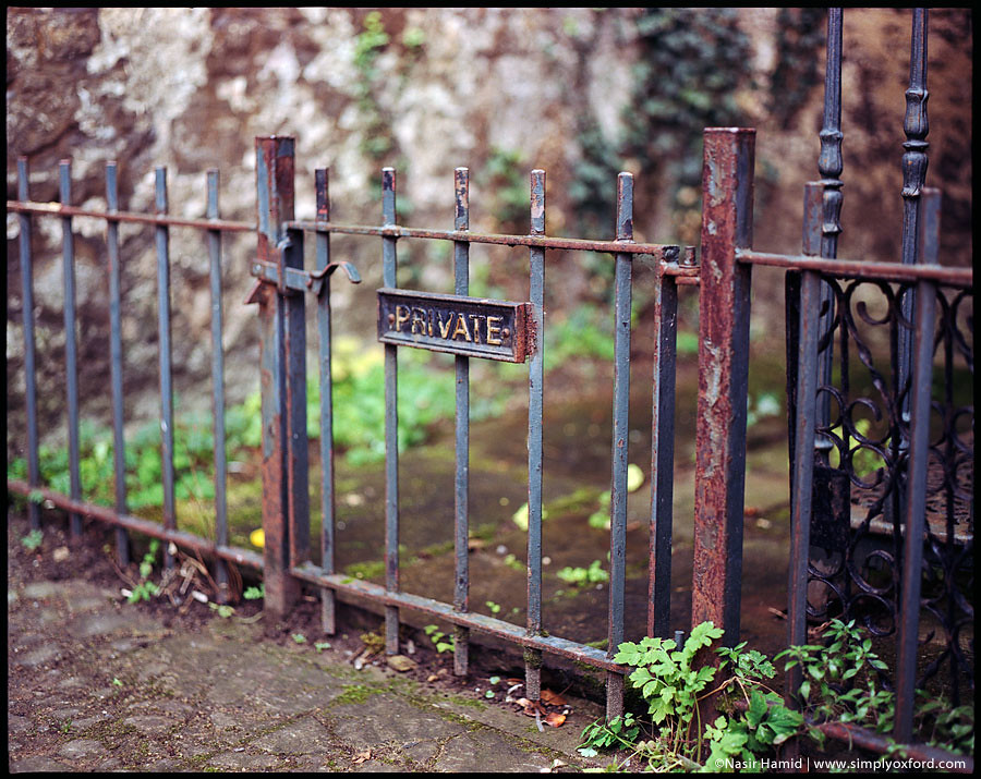 Private sign on rusty railings