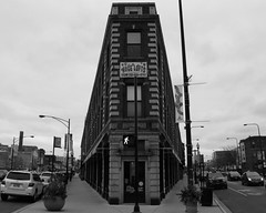 Wedge (Flint Foto Factory) Tags: city november autumn urban bw chicago building brick fall dark afternoon cloudy north broadway overcast convergence lakeview halsted flatiron wedge wrigleyville converge boystown 2011 northalsted