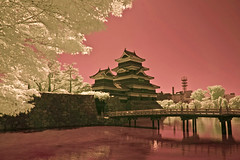 Matsumoto Castle, Moat. And Bridge In Infrared (aeschylus18917) Tags: castle nature japan architecture landscape ir nikon scenery d70 nikond70 fort surreal infrared keep  moat matsumoto fortress nagano 1870mm naganoprefecture  tenshukaku naganoken   matsumotocastle crowcastle  1870f3545g matsumotocity matsumotoj d700   nikond700 matsumotoshi karasujo nikkor1870f3545g danielruyle aeschylus18917 danruyle druyle   nikkor1870f3545gdx