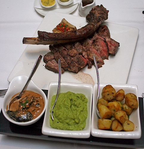 The Tomahawk steak came with portobello with morel cream, smashed peas and mint, and truffled kipfler potatoes