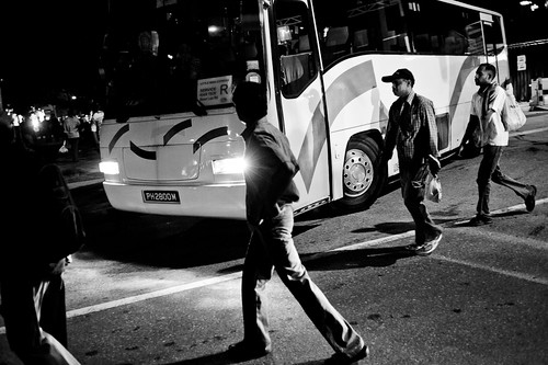 Men walking to their buses. The buses were all organized to bring them back to different parts of Singapore.