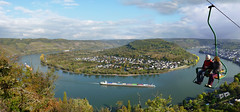 Overlooking a spectacular view of the great winding river Rhine (Bn) Tags: world panorama holiday heritage river germany season geotagged boats deutschland site vines topf50 europe wine bend ships churches kirchen cargo unesco upper valley middle fluss viewpoint rhine altstadt rhein unescoworldheritage rheinland oldcity hamm rijn steep chairlift duitsland riesling blackdiamond boppard rheinlandpfalz slopes mittelrheintal mhltal sesselbahn 50faves filsen vrachtschepen gedeonseck stoeltjeslift hirschkopf romanesquechurches romanischekirchen winegrowers boppardamrhein bopparder geo:lon=7572606 geo:lat=50243864