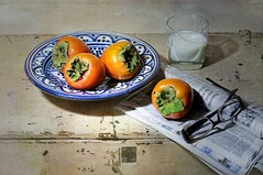 Persimmons with Milk (floralgal) Tags: stilllife texture fruit newspaper persimmons glassofmilk vintagetrunk tabletopstilllife classicstilllife milkwithpersimmons newspaperwithglasses