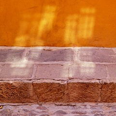shedding light on the narrow way (msdonnalee) Tags: muro wall cobblestones sidewalk minimalism minimalismo minimalist stucco lessismore minimalisme abstractreality reflectedsunlight minimalismus  narrowsidewalk  photosfromsanmigueldeallende mininalisme wallsofsanmigueldeallende thewayisnarrow fotosdesanmigueldeallende murosdesanmigueldeallende