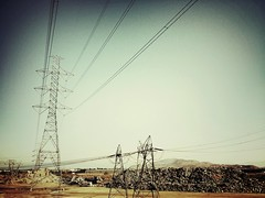 iPhoneography: Pylons (Dirk Dallas) Tags: cameraphone california blue sky art photography photo cool warm view riverside crossprocess cellphone pic powerlines wires desaturation desaturated pylons vignetting vignette app dirka iphone iphone4 dirkdallas iphoneography iphoneographer iphone4s snapseed