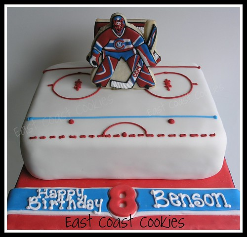 Goalie (Hockey) Cake with decorated cookies.