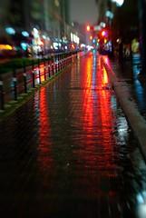 Downtown Lights (AlphaTangoBravo / Adam Baker) Tags: red black reflection wet rain night lensbaby lights downtown traffic houston reflect rainy handheld lensbabies assignment56 texasandmainst