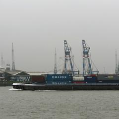 Vracht (Petra van der Ree) Tags: haven river ships cranes maas freight kranen rivier vrachtschip