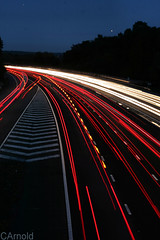 rush hour (justyourcofchi) Tags: road uk light england urban car night dark landscape photography model flickr photographer motorway headlights trail canon50mm chiarnold justyourcupofchicom justyourcupofchi