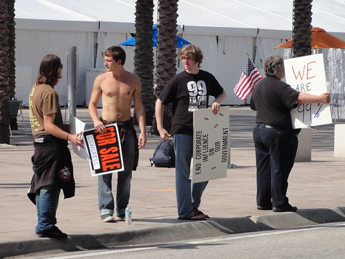 "Shirtless man with ""For Sale"" sign"