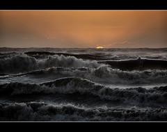 Sunset on gale - un piccolo dono per la mia amica   sogni di scricciolo (Sante sea) Tags: sunset sea italy rome roma italia tramonto mare wave gale burrasca ostia onde novembre2011challengewinnercontest